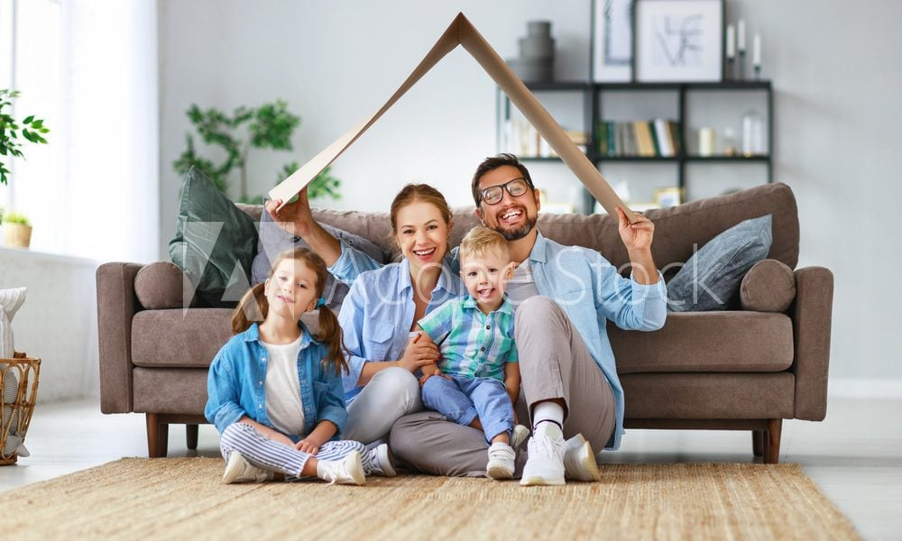 Family at home creating roof over head happy mum dad children daughter son
